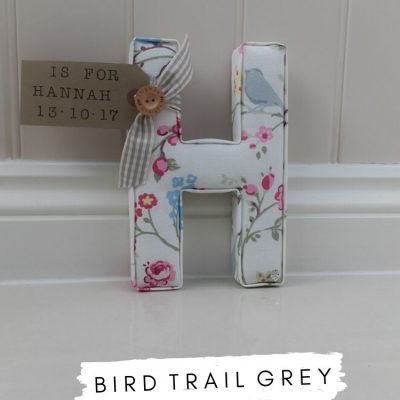 Clarke & Clarke Studio G Bird Trail Grey Fabric Grey Bird, with sage and pink detail. Personalised name tag Is for Hannah new baby girl present