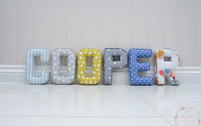 boys multi coloured nursery blues, yellows, grey, navy, circus theme padded wall initial letters name