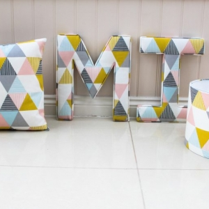 Extra large fabric letters and cushions covers. Twins nursery decor giant wall fabric nursery letters M & I handmade in the Brio Sorbet fabric. Pink, Blue & Yellow triangle detail. Lilymae Designs handmade in Colchester Essex UK. Large nursery wall ideas Personalised 35cm diameter lamp shade