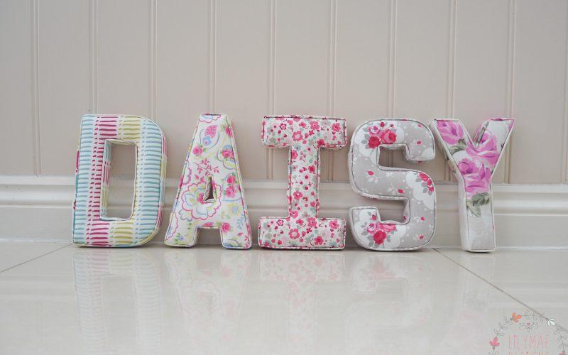 Handmade 22cm nursery wall letters spelling Daisy bright children decorations. Lilymae Designs