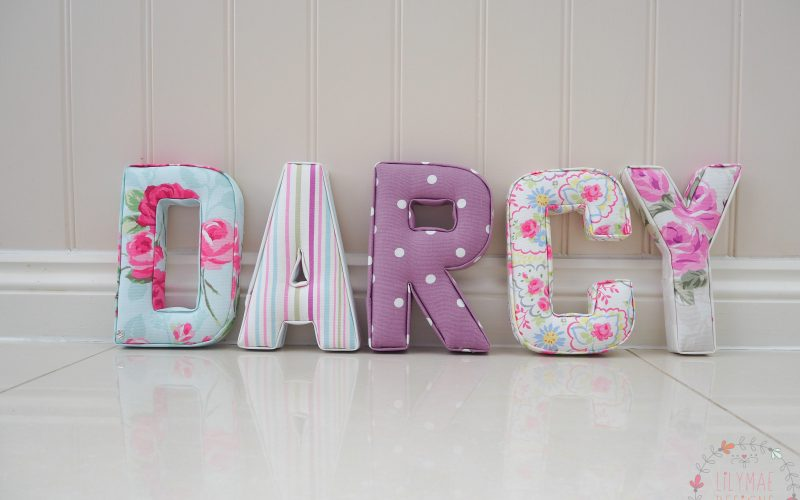 Nursery Wall letters spelling Darcy. Girls bedroom ideas blue, pinks and purple floral fabrics. Lilymae Designs