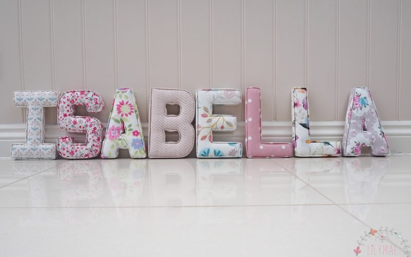 Beautiful fabric nursery letters Isabella pink floral fabrics, spotty fabrics, chevron fabrics, floral fabrics. Lilymae Designs