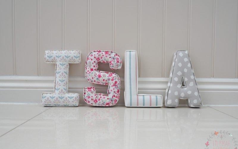 Girls nursery letters Isla. Handmade to order in Colchester Essex Lilymae Designs I Fleur blush, S Confetti Raspberry, L Walcott Pastel A Clio Smoke Studio G fabrics.