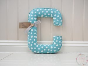 Large wall initial letter in Clio Aqua blue fabric. Personalised tag is for Caden