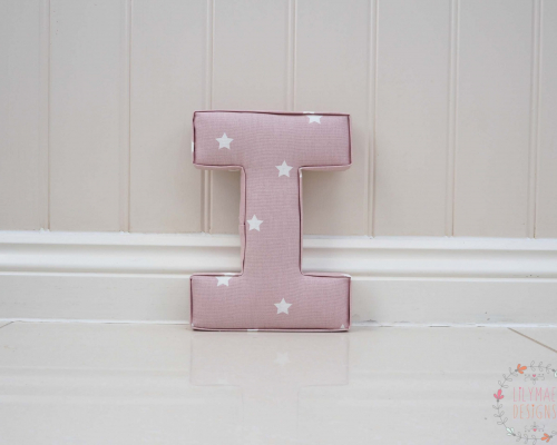 Letter I in pink star fabric ★ Lilymae Designs ★ We offer many items including Extra Large Fabric Letters in sizes 22cm tall, 25cm tall, 30cm tall, 40cm tall as well as custom sizes on request. Fabric Hearts, Butterflies, Stars, Birds, Bunting, Memo Boards, Extra Large Memo Boards, Cushions, Lampshades, Curtains and Roman Blinds Available in any of our Clarke and Clarke and Prestigious Textiles fabrics. Our personalised custom made to order products make great nursery decor, wall decor and home decor in any room. Also great gifts and presents, new baby, baby shower christening Little brother little sister niece nephew grandson godson granddaughter goddaughter first birthday children's birthday new home teacher dinner party gift mum present sister first home wedding best friends baby boy baby girl flower girl page boy bridesmaid rainbow baby mother's day, Mom, Nan, Auntie, Christmas xmas babys first Christmas daughter son Twins Fraternal Twins Support our small business today, each product is handmade to order here in the UK
